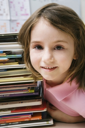 grade school age: Little Girl with a Stack of Books LANG_EVOIMAGES