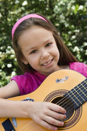 Little Girl Playing Guitar Stock Photo - 12592809