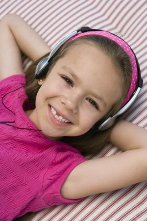6 7 year old: Little Girl Listening to Headphones