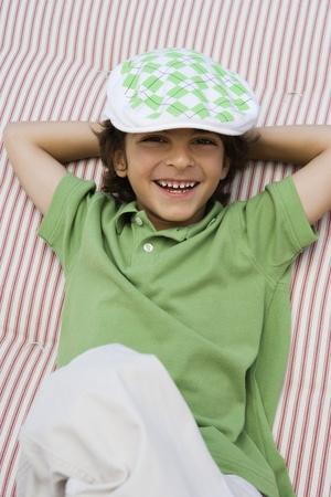 newsboy cap: Boy Wearing Newsboy Cap LANG_EVOIMAGES