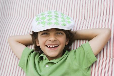 ethnic mixes: Boy Wearing Newsboy Cap LANG_EVOIMAGES
