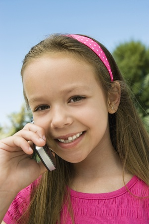 Young Girl Using Cell Phone Stock Photo - 12592834