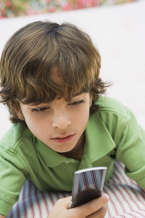 Young Boy Using Cell Phone Stock Photo - 12592840