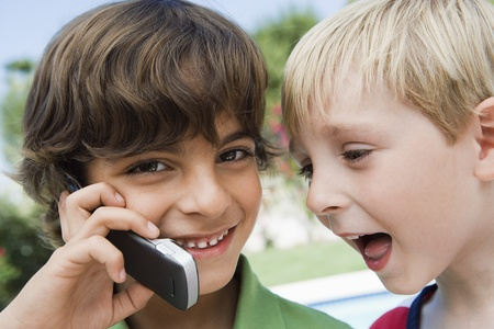 ethnic mixes: Young Boys Using Cell Phone