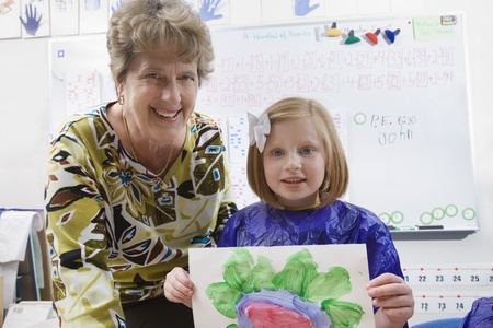 late fifties: Elementary Student and Teacher Showing Painting