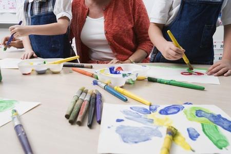 nurseries: Teacher Watching Students Paint