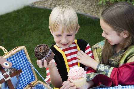 Kids Eating Cupcakes Stock Photo - 12592866