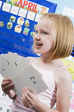 elementary student: Elementary Student with Alphabet Flash Cards