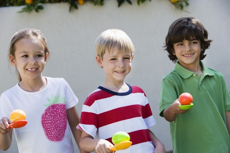 mix race: Kids Holding Eggs in Spoons for Egg Race