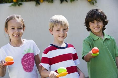Kids Holding Eggs in Spoons for Egg Race Stock Photo - 12592878