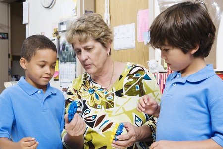 Teacher Talking with Elementary Students Stock Photo - 12592898