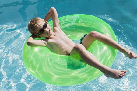 Boy on Float Tube in Swimming Pool Stock Photo - 12592904