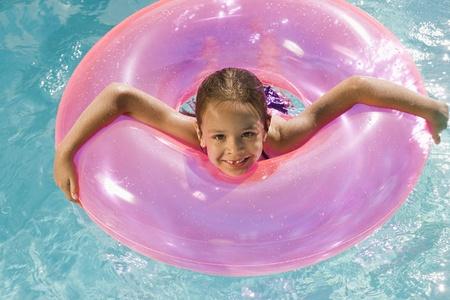 float tube: Girl Inside Pink Float Tube in Pool
