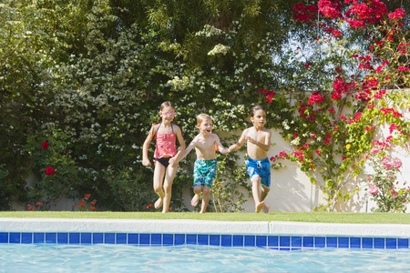 youthfulness: Kids Running Toward Swimming Pool