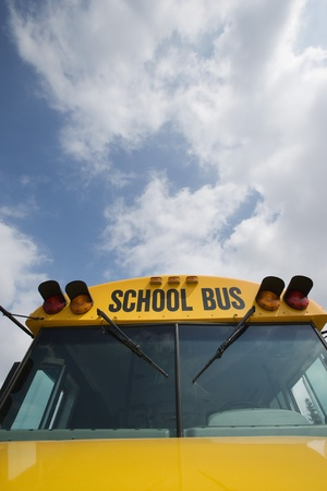 motorcoach: Caution Lights and Windshield of School Bus