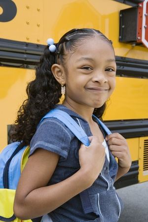School Girl by School Bus Stock Photo - 12592932