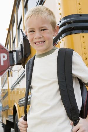 school buses: School Boy by School Bus LANG_EVOIMAGES