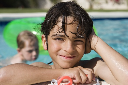 Boy at Edge of Swimming Pool Stock Photo - 12592945