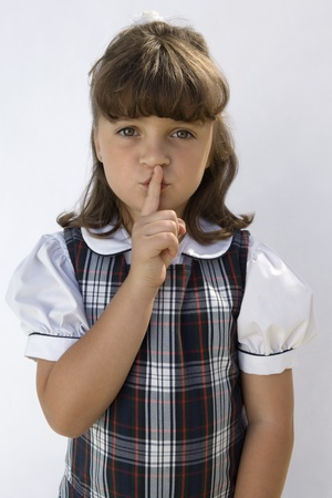 shush: Elementary Student with Finger on Lips