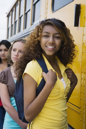 High School Girls Getting On School Bus Stock Photo - 12592955
