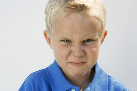 7 year old boys: Young Boy Glaring LANG_EVOIMAGES