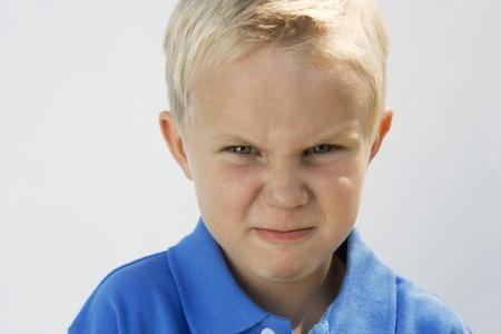 Young Boy Glaring Stock Photo