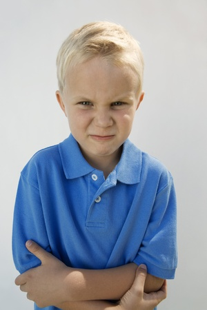 Young Boy Glaring Stock Photo