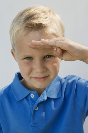 6 7 year old: Young Boy Saluting