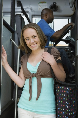 High School Girl Getting Off School Bus Stock Photo - 12592969