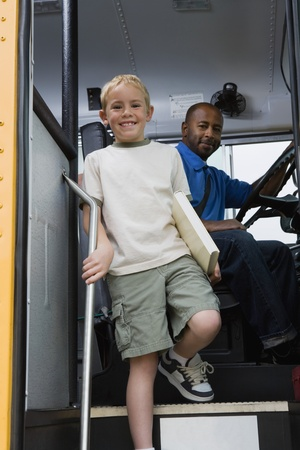 age 40 45 years: Little Boy Getting off of Schoolbus