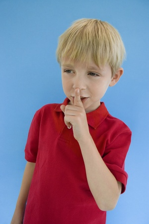 Boy with Finger on Lips Stock Photo - 12736357