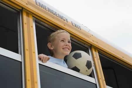 motorcoach: Boy on School Bus