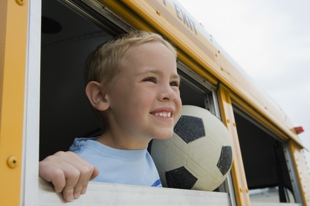 school buses: Boy on School Bus