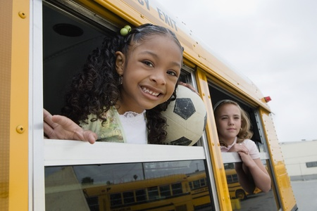 racially diverse: Elementary Students on School Bus