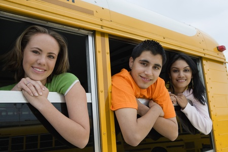 motorcoach: High School Students Looking Out Windows of School bus LANG_EVOIMAGES