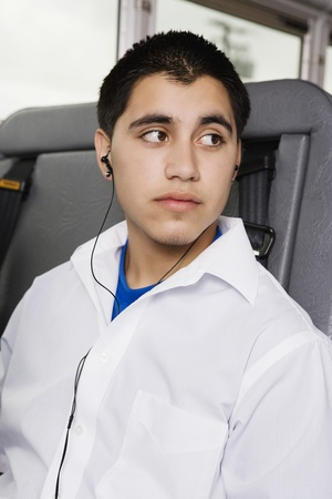 teenaged boys: Teenage Boy Listening to MP3 Player on Bus LANG_EVOIMAGES