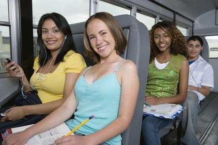 mixed ethnicities: Teenagers Riding School Bus
