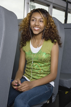 motorcoach: Teenage Girl Listening to MP3 Player on Bus