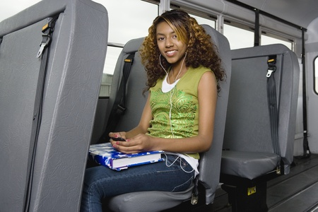 motorbus: Teenage Girl Listening to MP3 Player on Bus