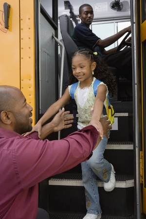 racially diverse: Father Picking Daughter Up at Bus Stop