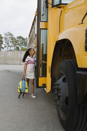 motorcoach: Elementary Student Getting onto School Bus