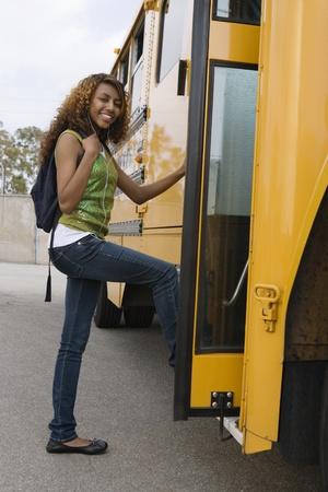 age 16 17 years: Teenage Girl Getting on School Bus LANG_EVOIMAGES