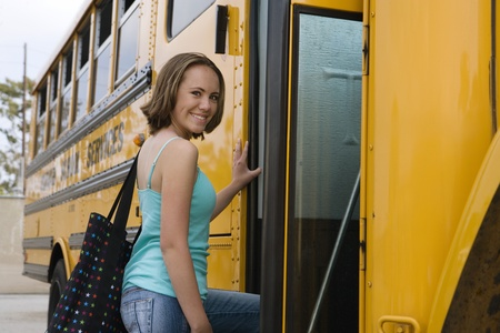 early teens: Teenage Girl Getting on School Bus LANG_EVOIMAGES