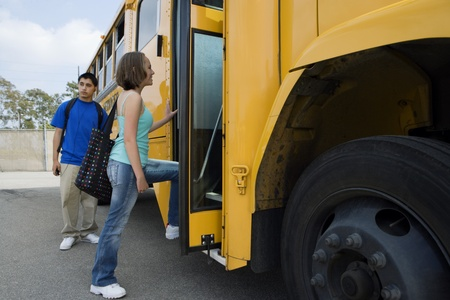 Teenage Girl Getting on School Bus Stock Photo - 12736423