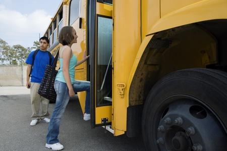 teenaged boys: Teenage Girl Getting on School Bus LANG_EVOIMAGES