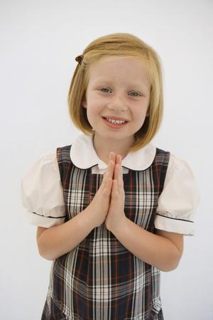 learning pray: Girl Wearing School Uniform