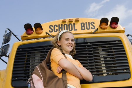 10 to 12 year olds: Elementary Student Standing by School Bus LANG_EVOIMAGES