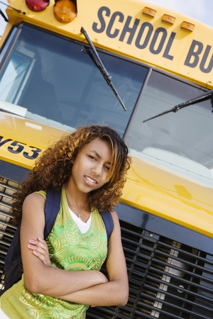 motorcoach: Teenager Girl by School Bus LANG_EVOIMAGES