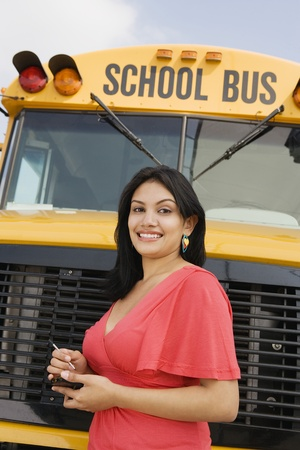 Teenager Girl by School Bus Stock Photo