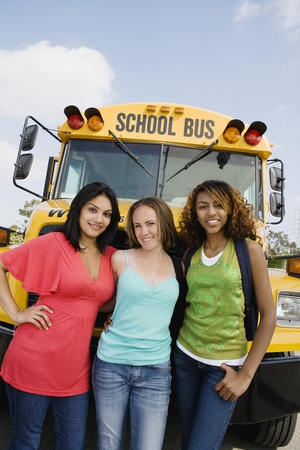 racially diverse: Teenage Girls by School Bus